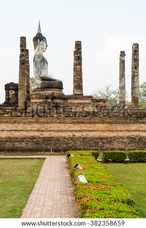 Walkway to old buddha in the temple at Sukhothai Historical Park in Sukhothai Province, Thailand - stock photo