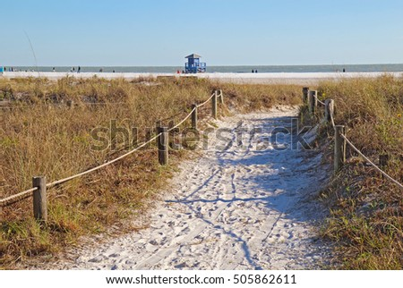 Walkway to the white sand beach and lifeguard station at Siesta Key Beach near Sarasota, Florida