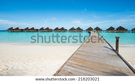 Walkway to water bungalow, Maldives - stock photo