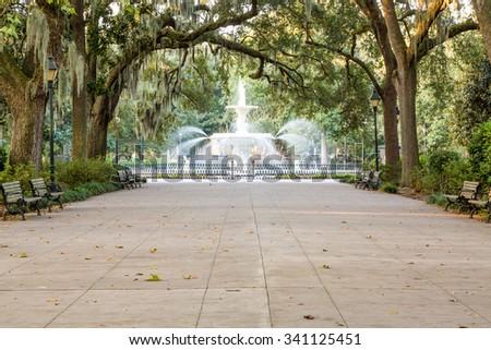 Walkway under southern oaks toward the fountain in Forsyth Park, Savannah, Georgia - stock photo
