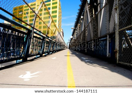 Walkway with fenced on the Manhattan Bridge in New York - stock photo