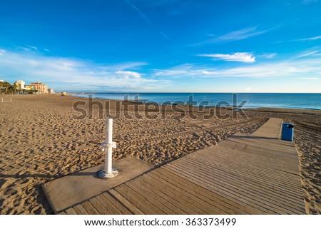Walkway with footwash on Torevieja beach, Costa Blanca - stock photo