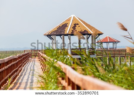 walkway with old pavilion in lake of thailand. - stock photo