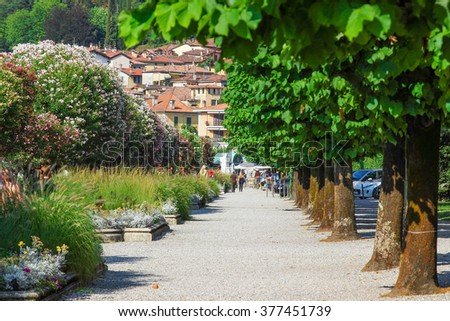 Walkway with trees in Bellagio, Como lake, Italy. Summertime. - stock photo