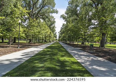 Walkways at the public Liberty Park in Salt Lake City, Utah. - stock photo