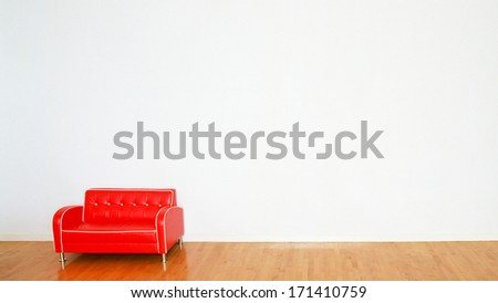 wall and red sofa  - stock photo