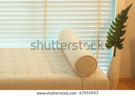 wall and white sofa in modern interior - stock photo