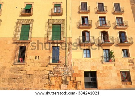 Wall and windows of an old building in Tarragona, Catalonia, Spain