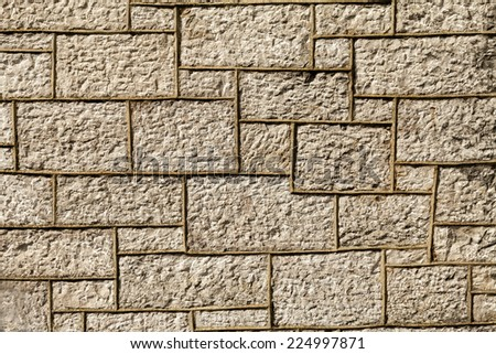 Wall background built in the year 1856. The brickwork is a type of  limestone from Llanddulas North Wales Great Britain - stock photo