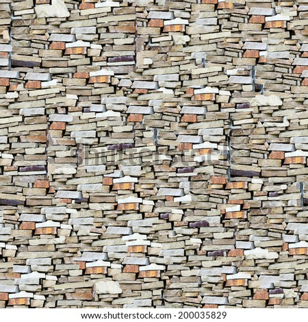 Wall background with grey and yellow stones.  - stock photo