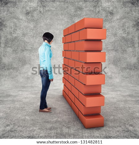Wall before the girl as the fear concept - stock photo