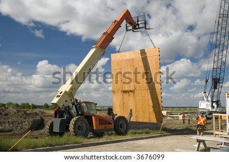 Wall being moved by a Boom lift. - stock photo