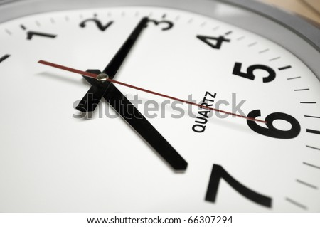 Wall clock. Arrows indicates 7:15 - Time to go to work! - stock photo