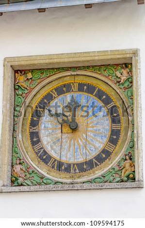 Wall clock in Old Town of Tallinn, Estonia - stock photo