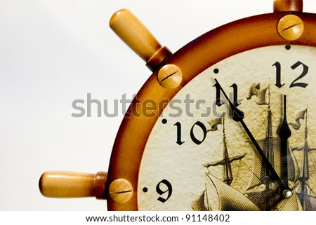 wall clock in the form of the wheel show without five minutes to twelve isolated - stock photo