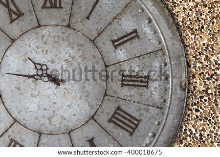 Wall clock old rusty grunge on stone wall background, (with clipping path)