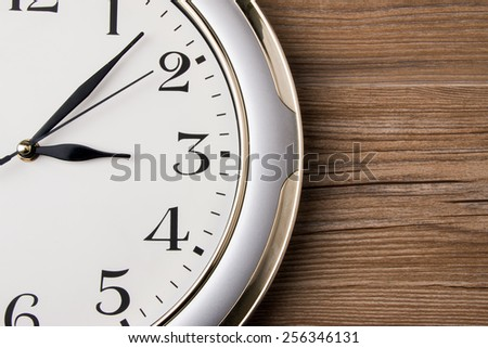 wall clock on wooden background - stock photo