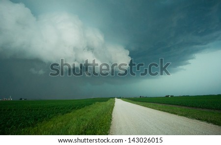 Wall cloud on the leading edge of severe weather. - stock photo