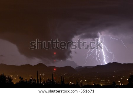 Wall cloud or funnel cloud with lightning during severe thundershower in desert southwest United States - stock photo