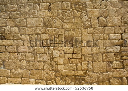 Wall constructed of stone bricks. A fine textural background for graphic design - stock photo