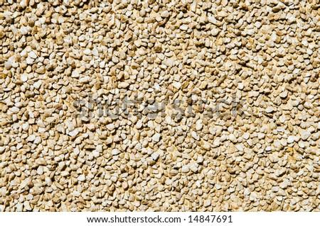 wall decor in small pebble stone - stock photo