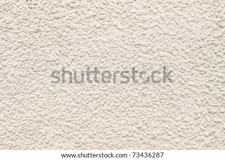 Wall decorated by small pieces of stone and coated by water color - stock photo