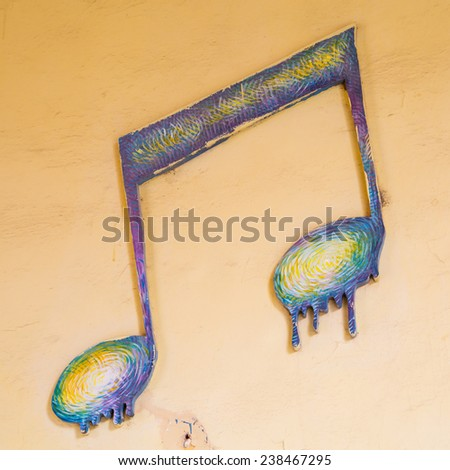 Wall decorated with music notes - stock photo