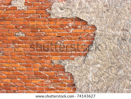 Wall for background texture with damaged plaster and bricks - stock photo