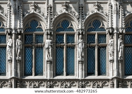 Wall fragment of the Town Hall of the City of Brussels is a Gothic building from the Middle Ages with three sculptures on the parties of windows