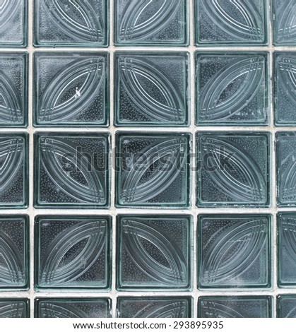 Wall from glass transparent square blocks closeup - stock photo