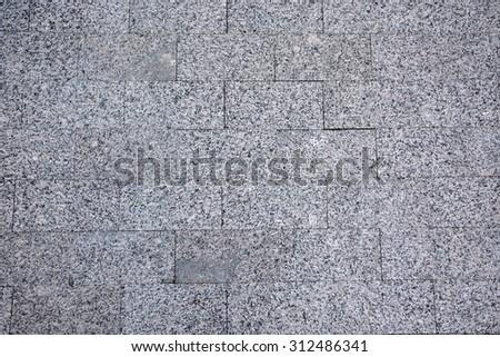 Wall from granite bricks. Background, texture - stock photo