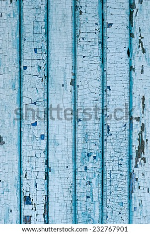 Wall from wooden planks with blue paint. Cracked paint on a wooden planks.  - stock photo