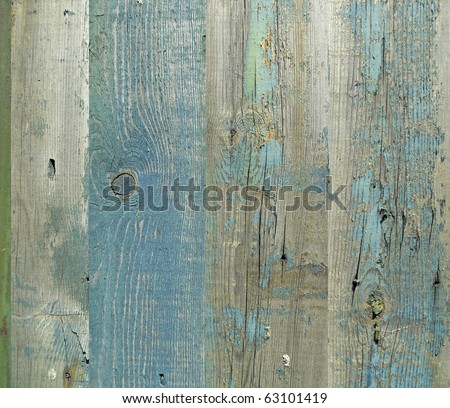 Wall from wooden planks with paint traces - stock photo