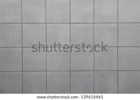 Wall grey tiles background. - stock photo