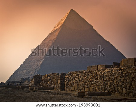 Wall in front of the great pyramid of Giza in Egypt during sandstorm. - stock photo