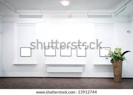 wall in museum with empty frames - stock photo