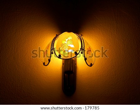 Wall lamp in dark room - stock photo