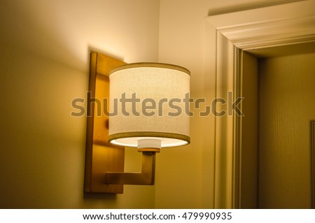 Wall lamp in shadow at long shutter speed