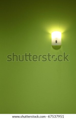 Wall lamp on the green background - stock photo