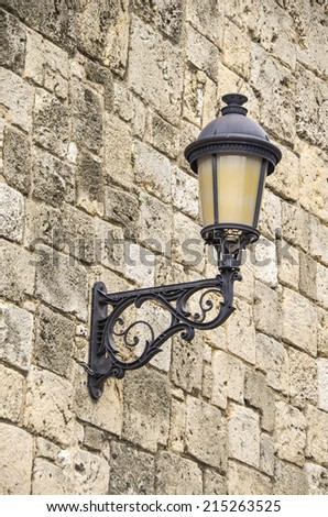 Wall lamp with stone background. - stock photo