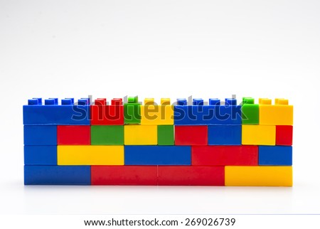 Wall made from plastic building blocks. - stock photo
