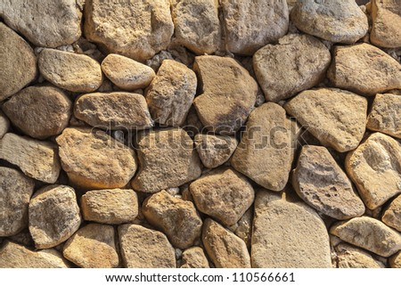 Wall made from rocks - stock photo