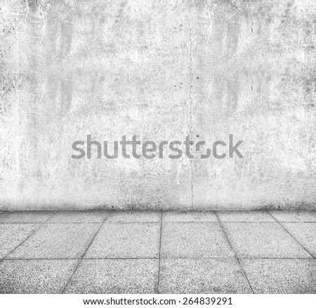 Wall made of concrete and floor from stone - stock photo