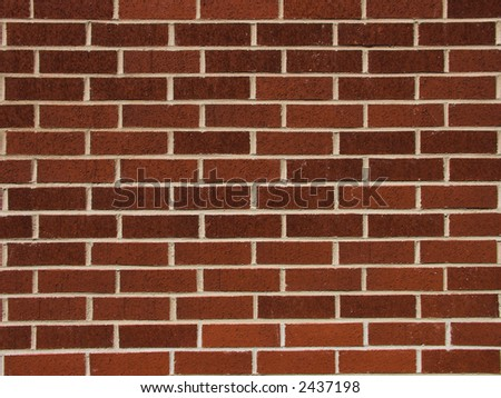Wall made of dark red bricks - good for background - stock photo