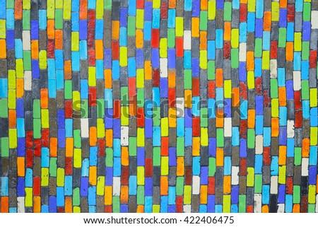Wall made of multicolored bricks blocks. - stock photo