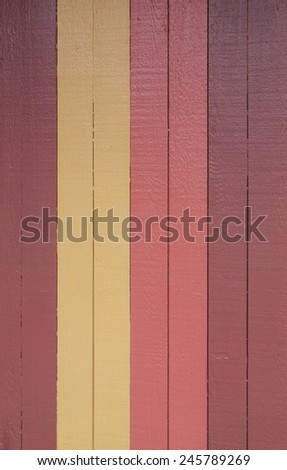 Wall made out of wood painted of different colors as background
