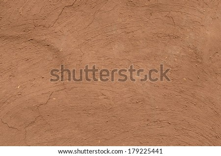 Wall made up of mud used in rural part of India for building houses, with lot of copy space for messages - stock photo