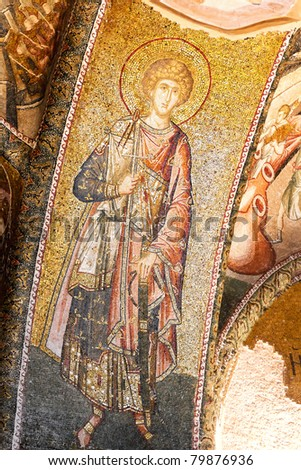Wall mosaics of ancient Chora Church, Istanbul. Byzantine military saint in rich dresses. 14th Century, Constantinople - stock photo