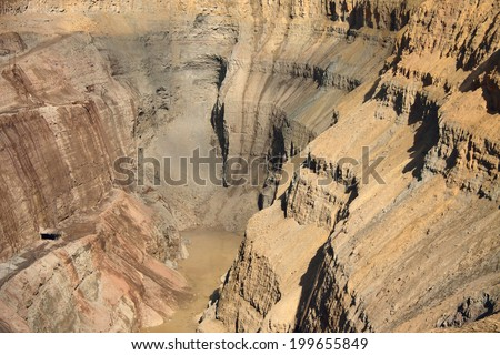 Wall of a diamond open pit consisting of solid rock  - stock photo