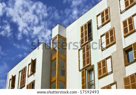 Wall of a house with windows and jalousie on them